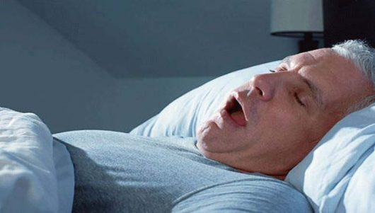 How to not snore while sleeping on back